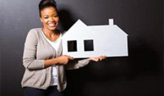 woman holding a house figure